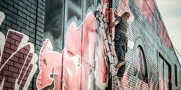 Man drawing graffiti