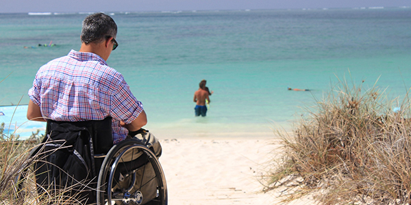 Man with disability by the sea