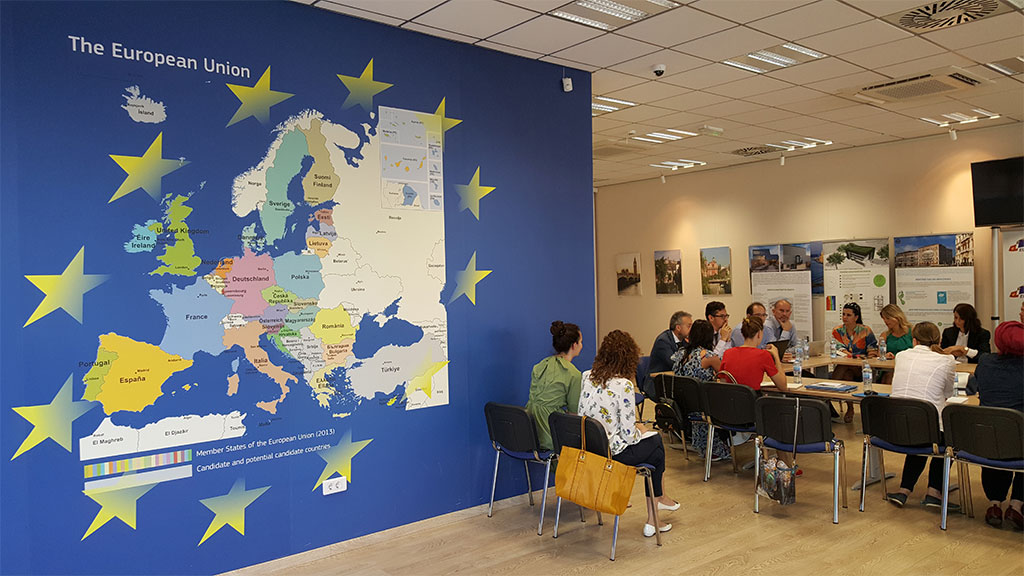Meeting next to the map of the European Union